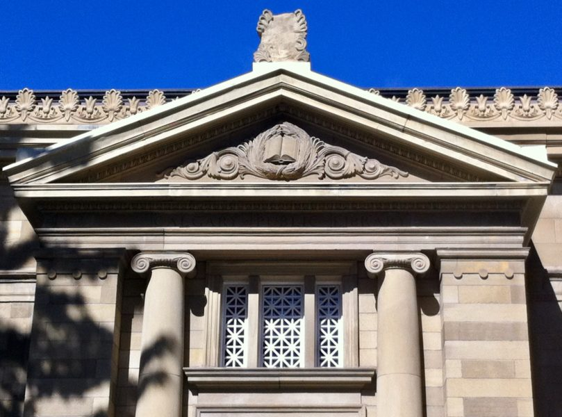 Image of the relief of an open set above the main entrance of the Memorial Park Library